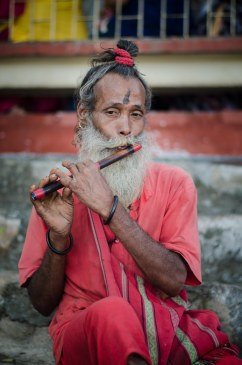 Devotee playing the flute.